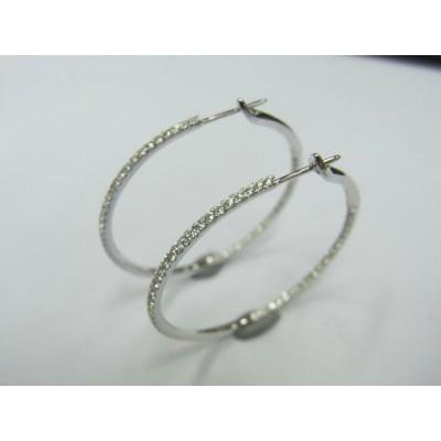 Pair of 18 karat white gold diamond hoops.