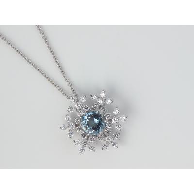 Aquamarine diamond snow flake pendant.