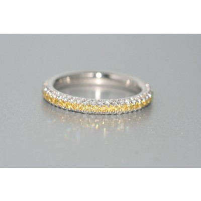 platinum  and 18 karat yellow gold  fancy yellow and white diamond eternity band.