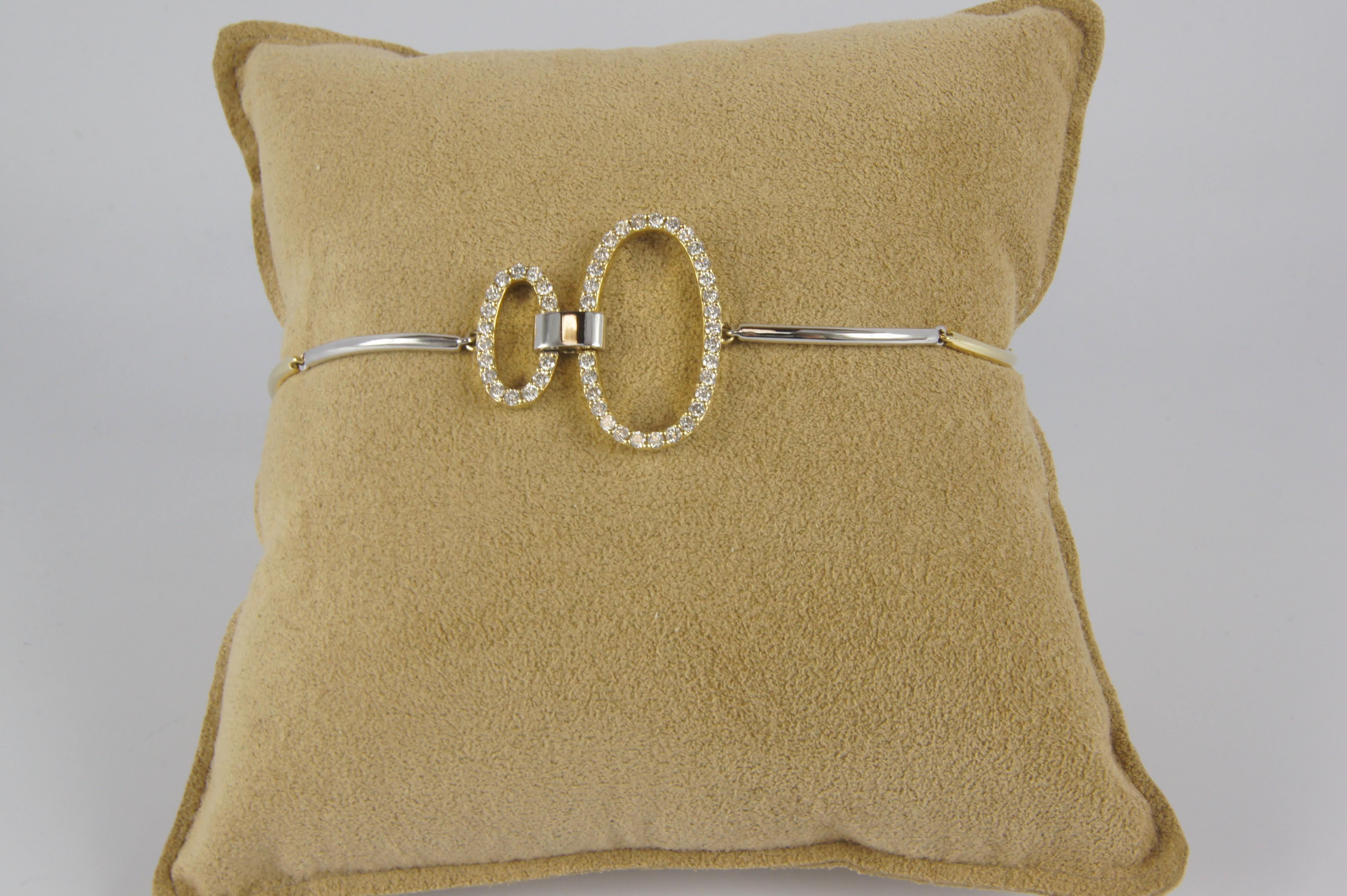 Two tone diamond link bracelet with diamonds.