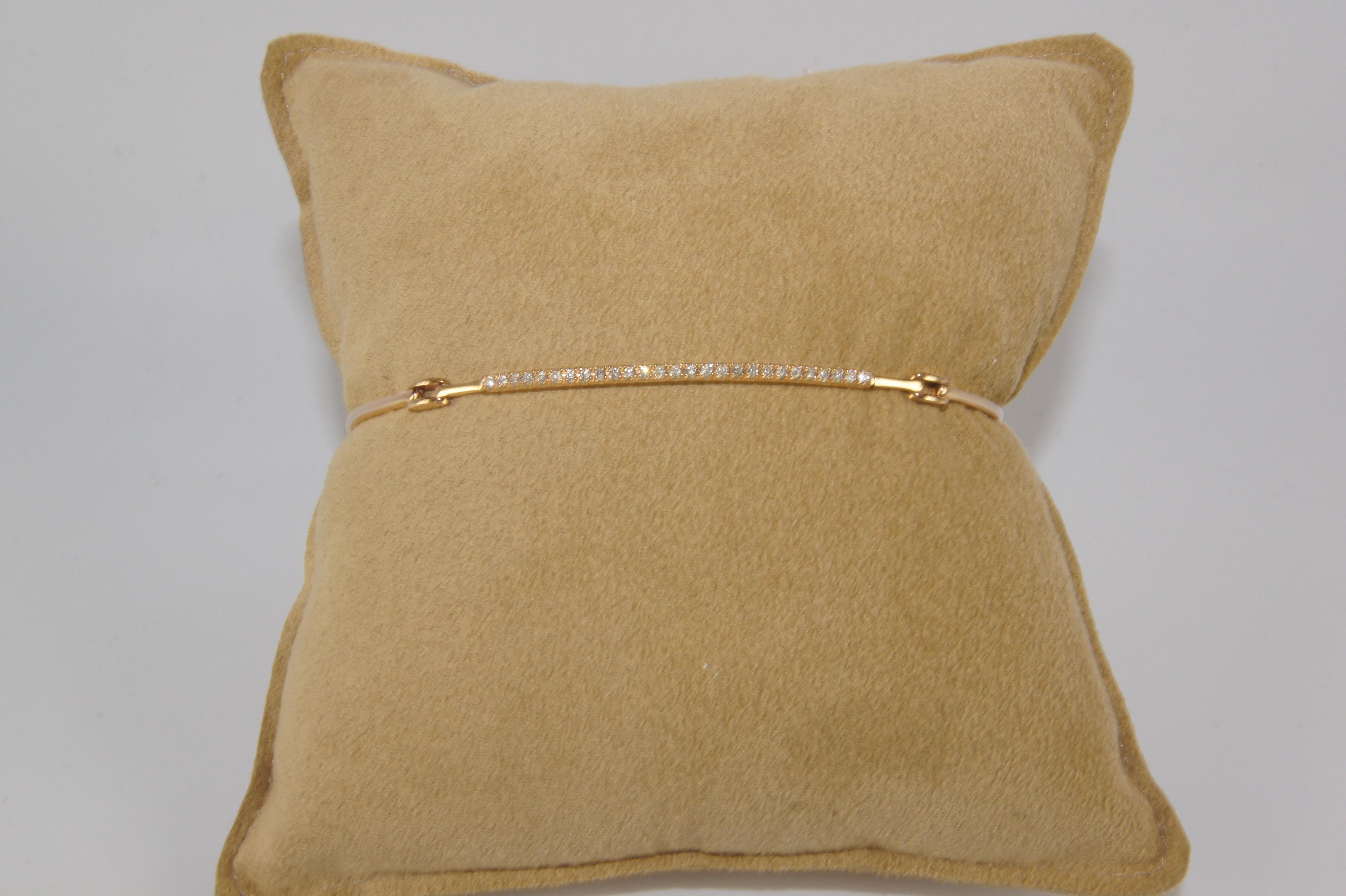 18 karat rose gold diamond link bracelet.