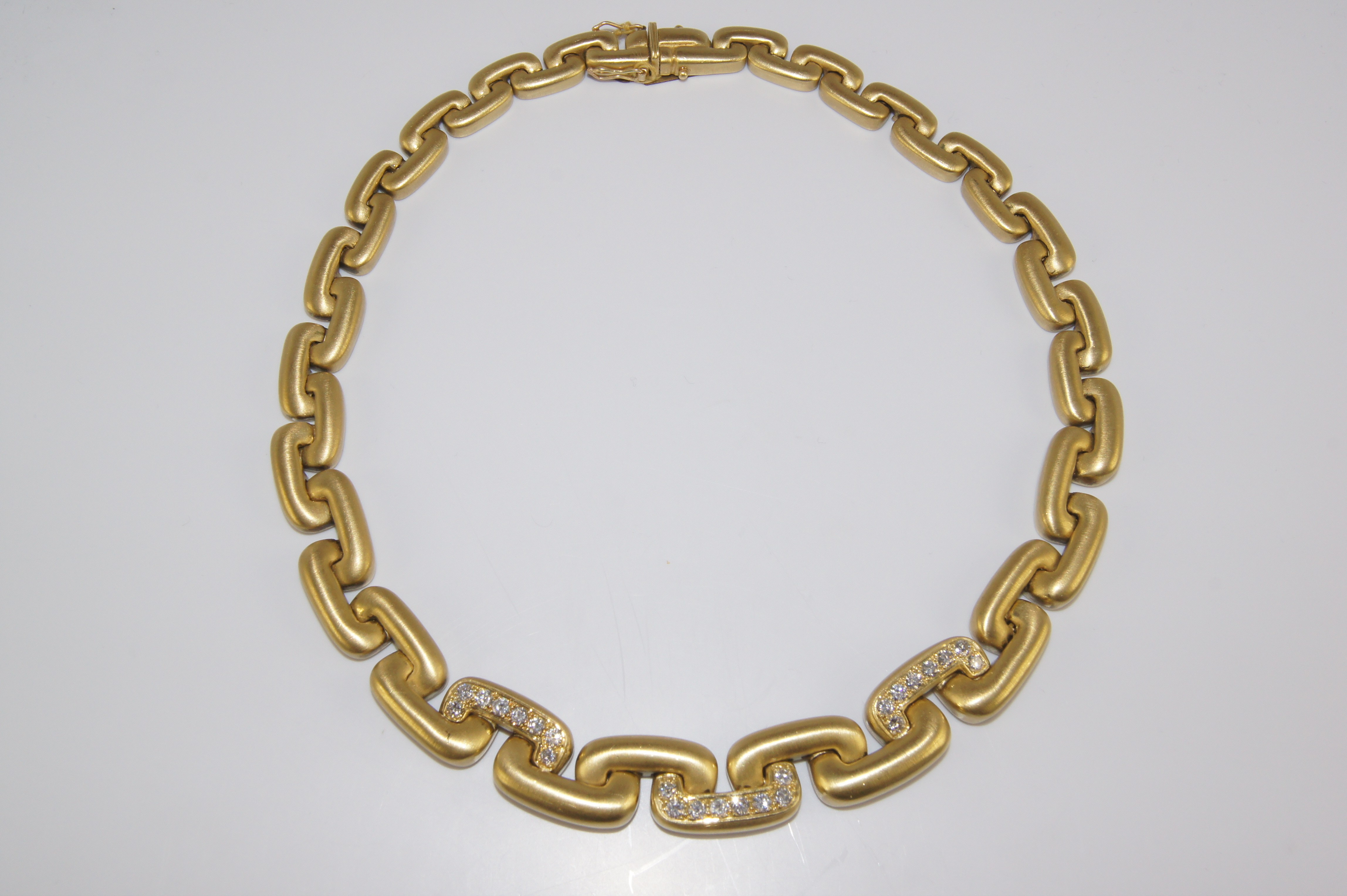 18 karat diamond link necklace.