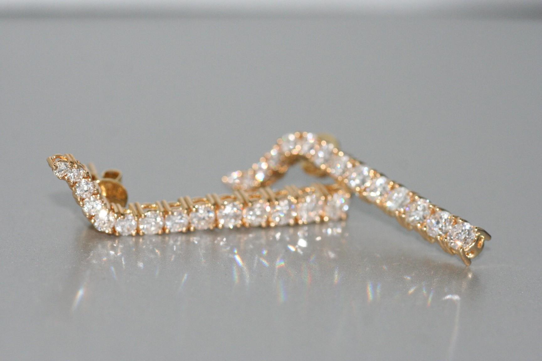 A Pair of 18 Karat Yellow Gold Diamond Earrings