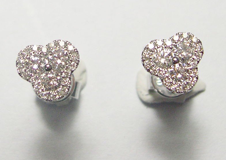 Diamond 3 sided stud earrings.