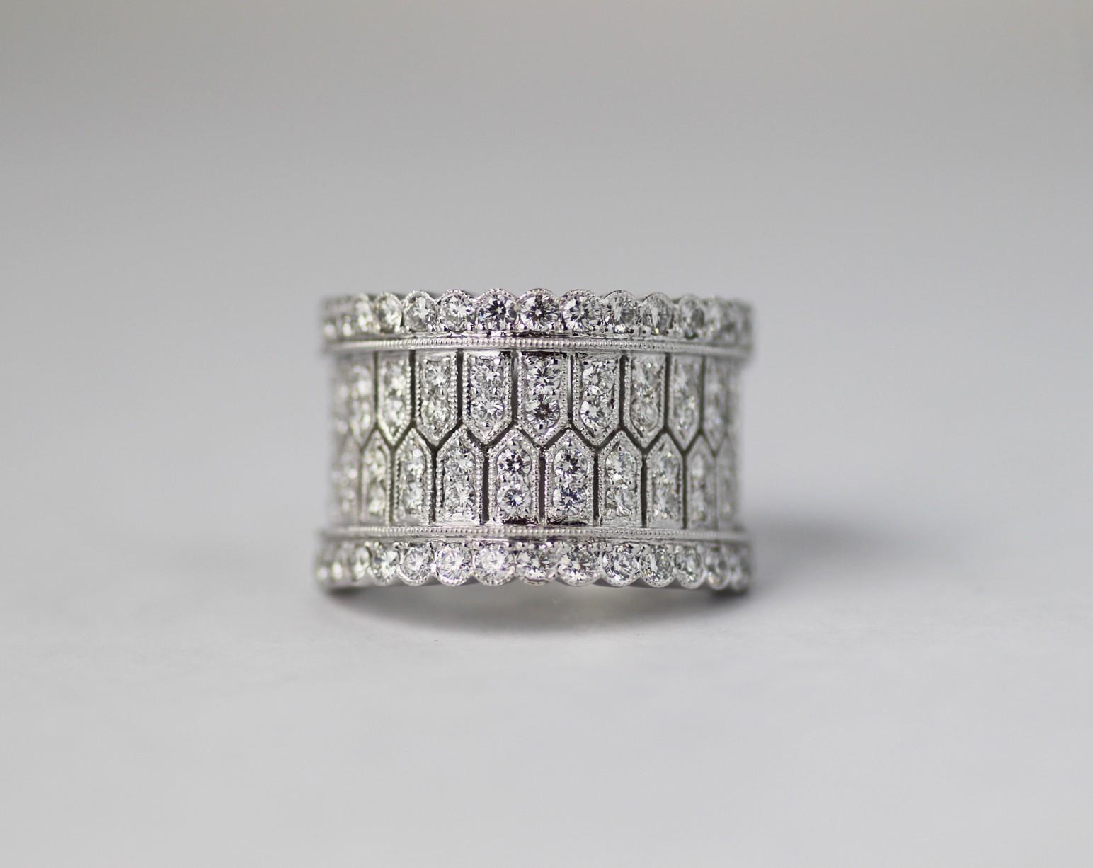 18 karat white diamond band.