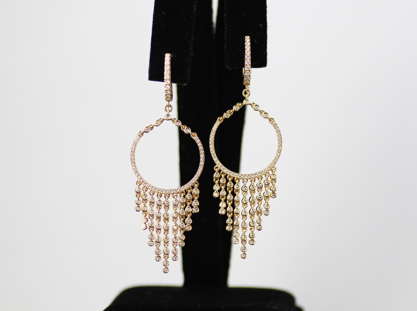 18 karat yellow diamond dangle earrings.