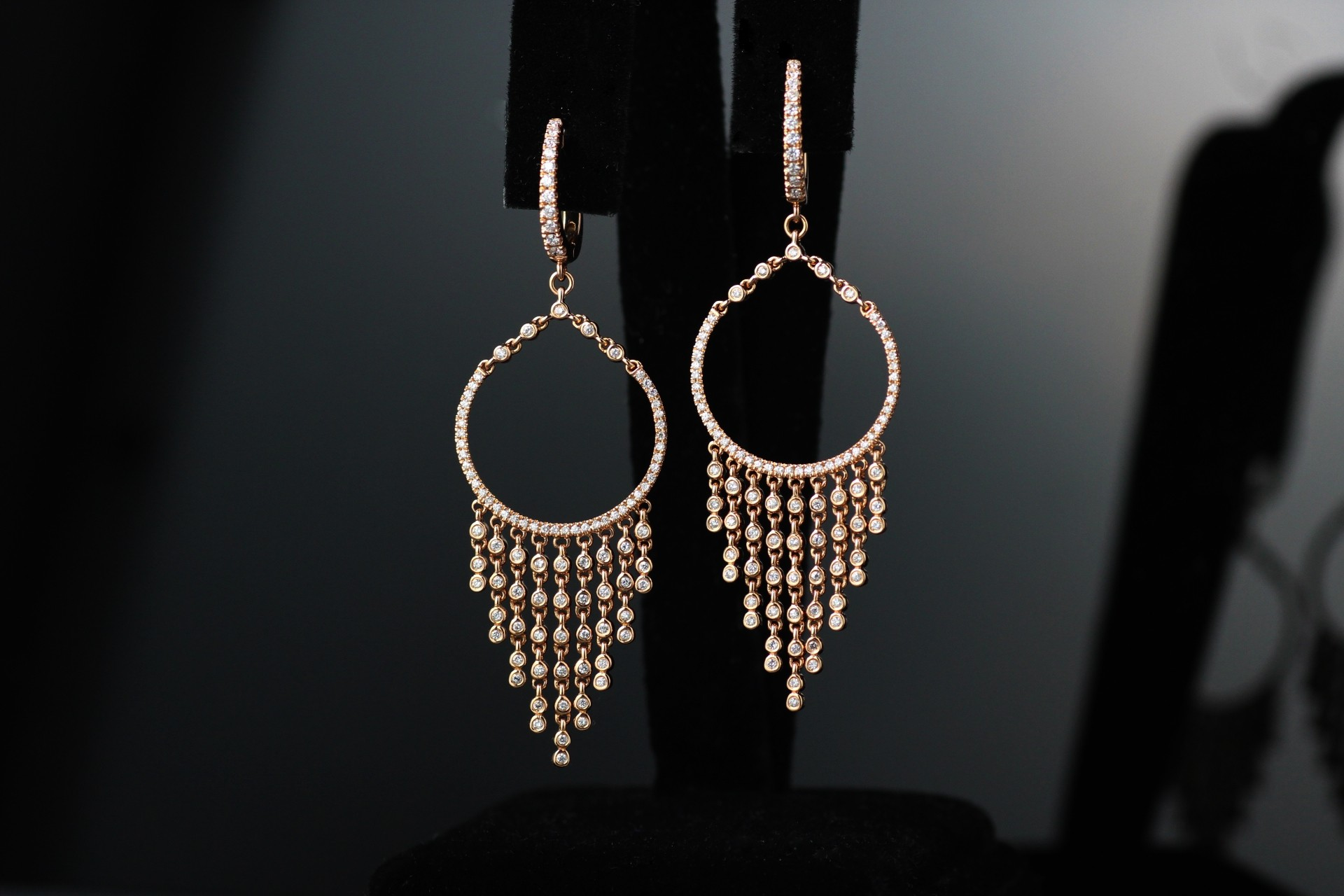 18 karat rose gold diamond chandelier earrings.