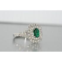 Platinum diamond and tsavorite halo ring.