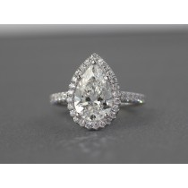 Pear shape diamond halo ring.