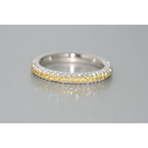 platinum  and 18 karat yellow gold  fancy yellow and white diamond eternity band.