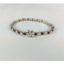 18 Karat White Gold Diamond and Ruby Tennis Bracelet.