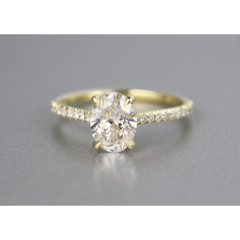 18 karat yellow gold oval diamond engagement ring.