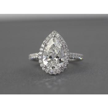 Pear shape diamond halo ring.